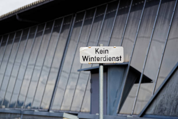 No Winter Maintenance warning sign in german against facade stock photo