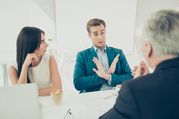 No. Young businessman don't want to sign contract No. Young businessman don't want to sign contract single word no stock pictures, royalty-free photos & images