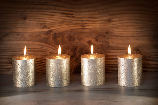 noble candles against a background of wood - trauer abschied tod stock-fotos und bilder
