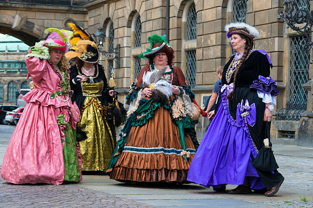 noble ladys in baroque clothes walking trough dresden - petticoat stock pictures, royalty-free photos & images