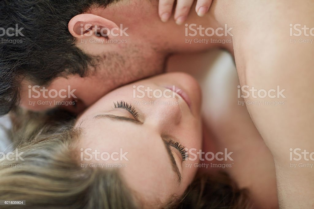 Nobody is immune to the neck kiss stock photo
