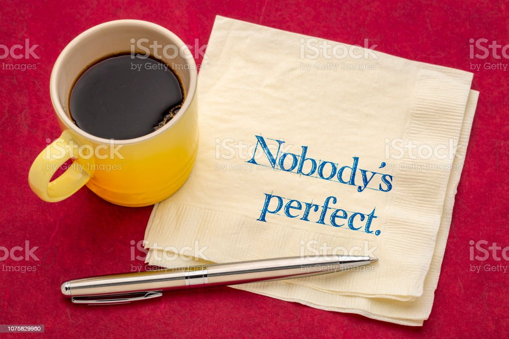 Nobody is perfect note on napkin stock photo