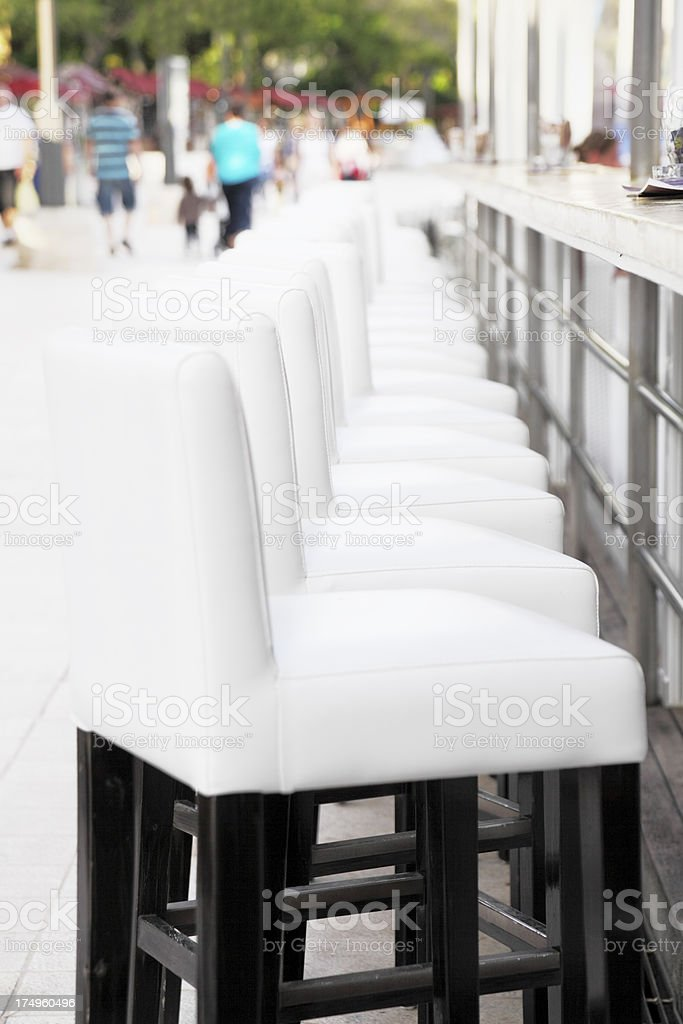nobody on white leather bar stools in Croatia royalty-free stock photo