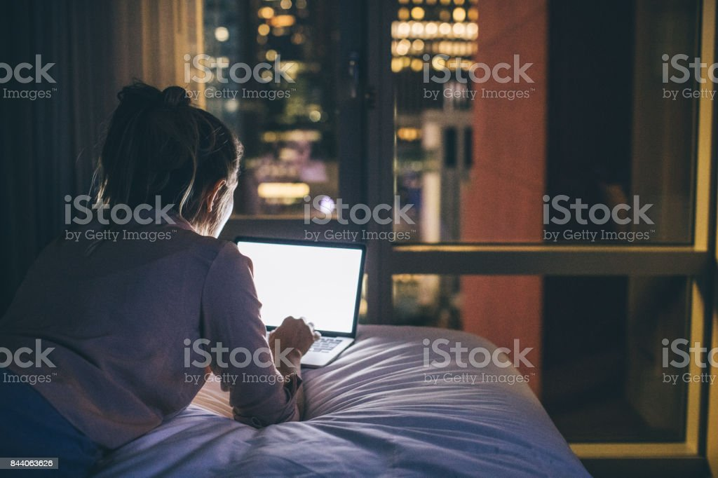 Nocturnal socializing online stock photo