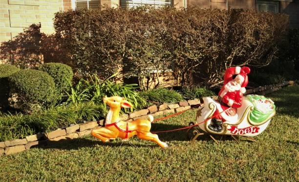 Noel Santa on a Sleigh Pulled by a Reindeer Lawn Ornament -- Day stock photo