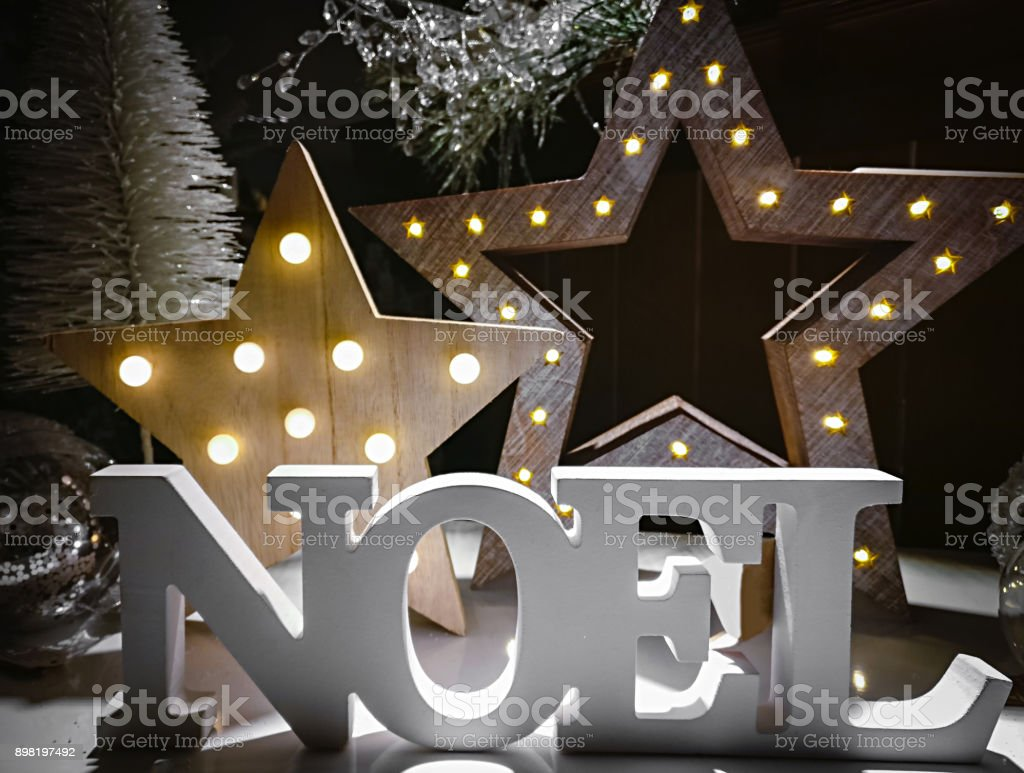 Immagini Natalizie Word.Noel Word Made Of Wooden Letters On A Background Illuminated With