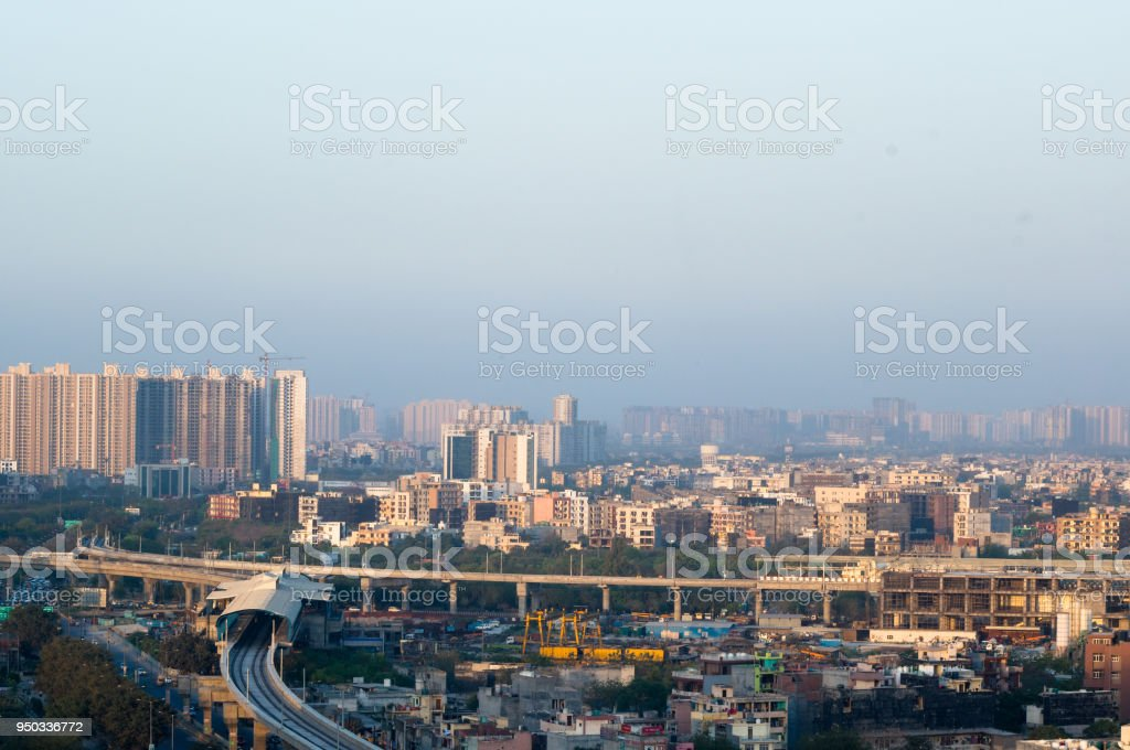 Noida Delhi cityscape with buildings and metro station stock photo