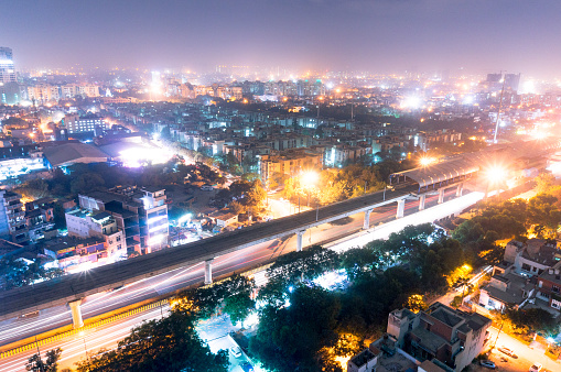 Noida Metro Station At Night Against The Cityscape Stock