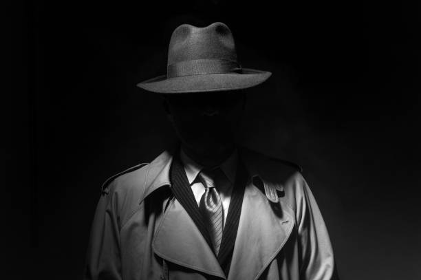 noir movie character - enigma images stock photos and pictures