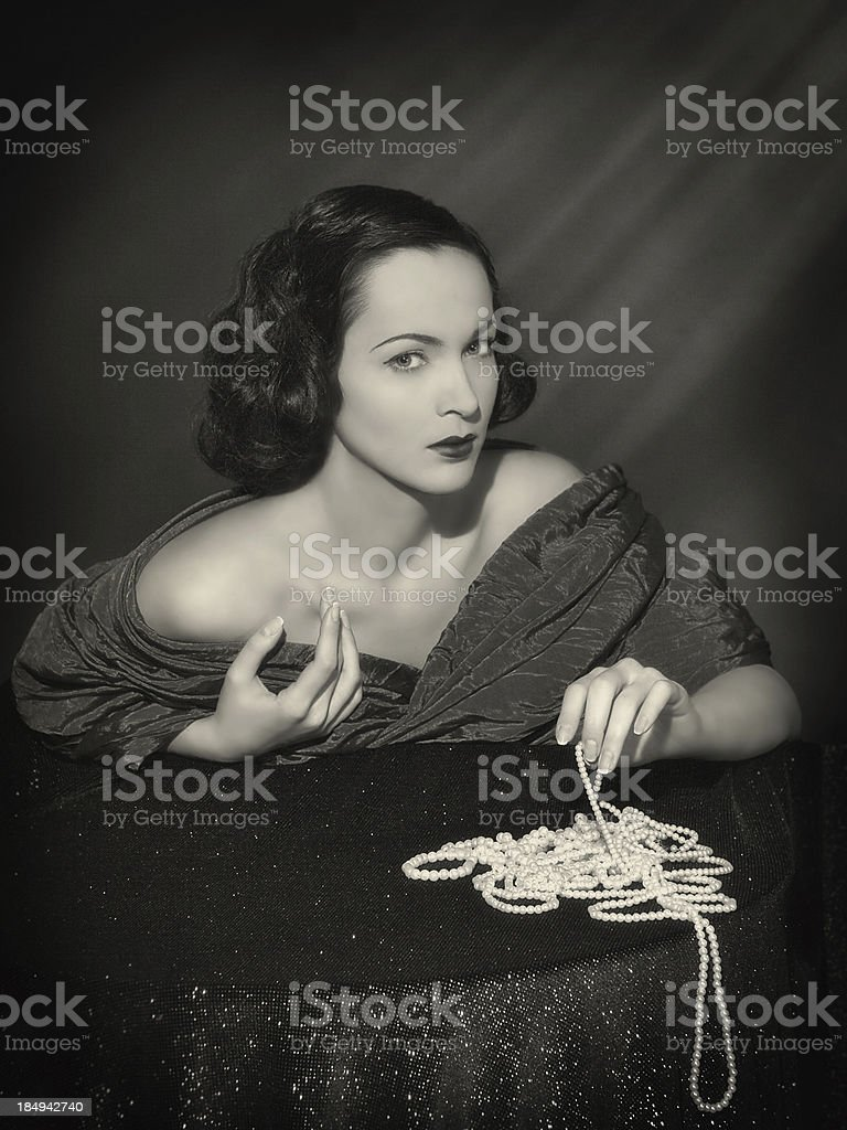 Noir style.Diva with necklace royalty-free stock photo
