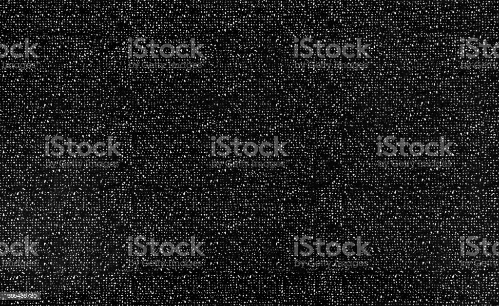 Noise texture paper stains for dots pattern graphic design on black and white grain background. Close up. royalty-free stock photo