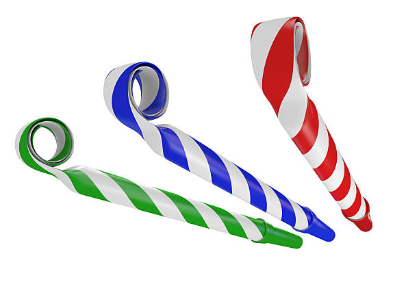 3D noisemaker paper horns for birthday parties and celebrations stock photo