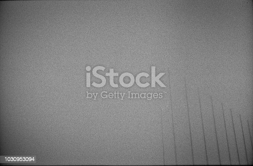 1143033009 istock photo Noisy film frame with dust and grain 1030953094