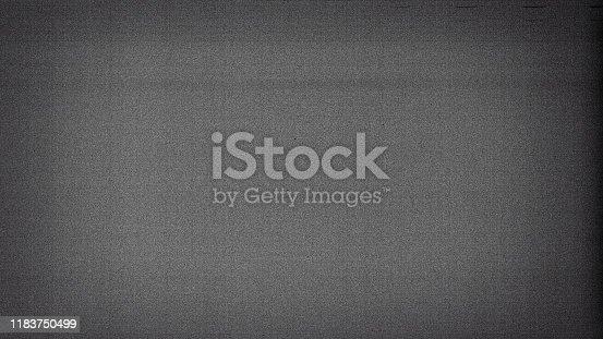 1143033009 istock photo Noisy film frame with heavy noise, dust and grain 1183750499