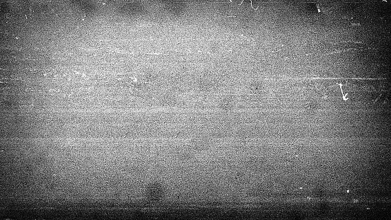 Noisy film frame with heavy scratches, dust and grain. Abstract old film background