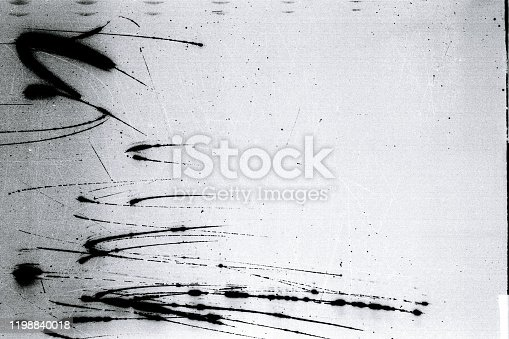 1143033009 istock photo Noisy film frame with heavy scratches, dust and grain 1198840018
