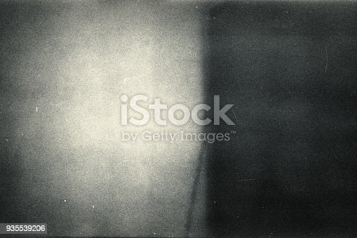 1143033009 istock photo Noisy film frame with heavy scratches, dust and grain 935539206