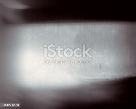 1131841696 istock photo Noisy film frame with heavy scratches, dust and grain 954271370
