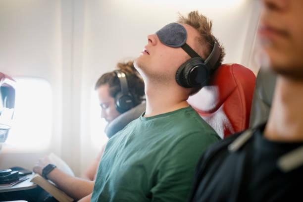 Noisy Snorer on a Flight stock photo