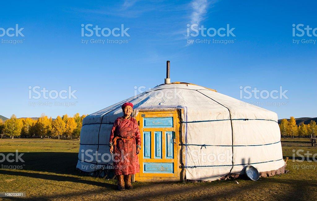 Nomadic Mongolian Woman in Front of Yurt stock photo