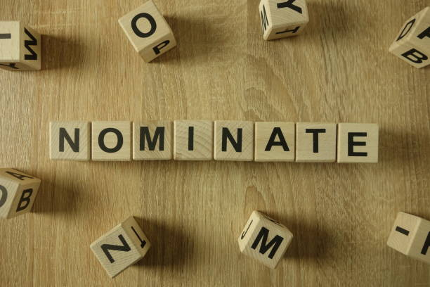 nominate word from wooden blocks - word game stock pictures, royalty-free photos & images