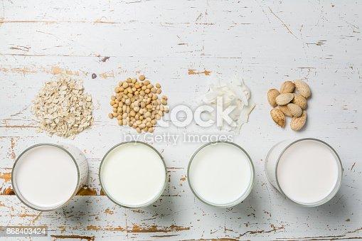 Non dairy milk concept - milk alternatives in glasses