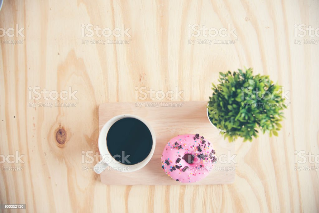 Non diet snack, strawberry donut and black coffee  for chubby fat woman. stock photo