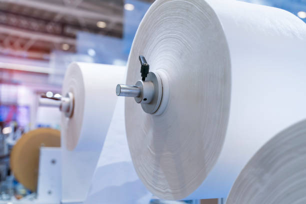non woven material on automatic machine for the manufacture of medical masks with nanofiber. stock photo