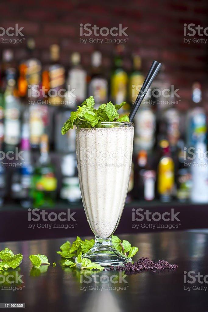 non-alcoholic chocomint milkshake cocktail on the classic black bar table stock photo