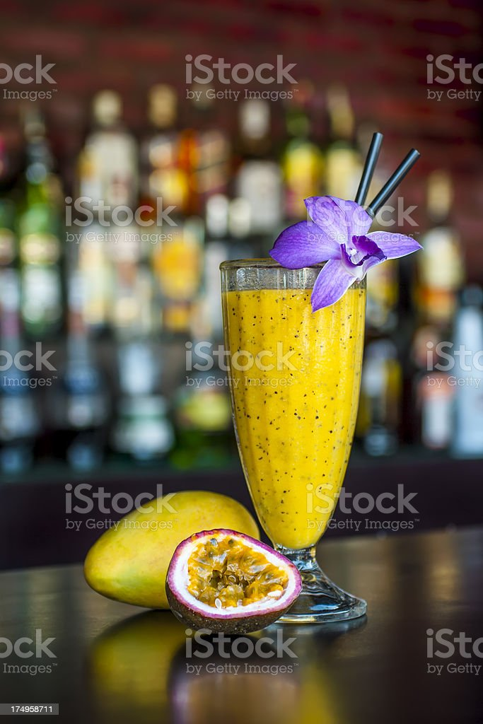 non-alcoholic mango passion cocktail on the classic black bar table stock photo
