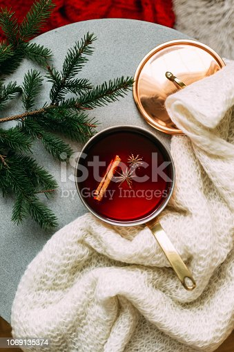 Non-alcoholic mulled wine with lemon and cinnamon in glass, flat lay