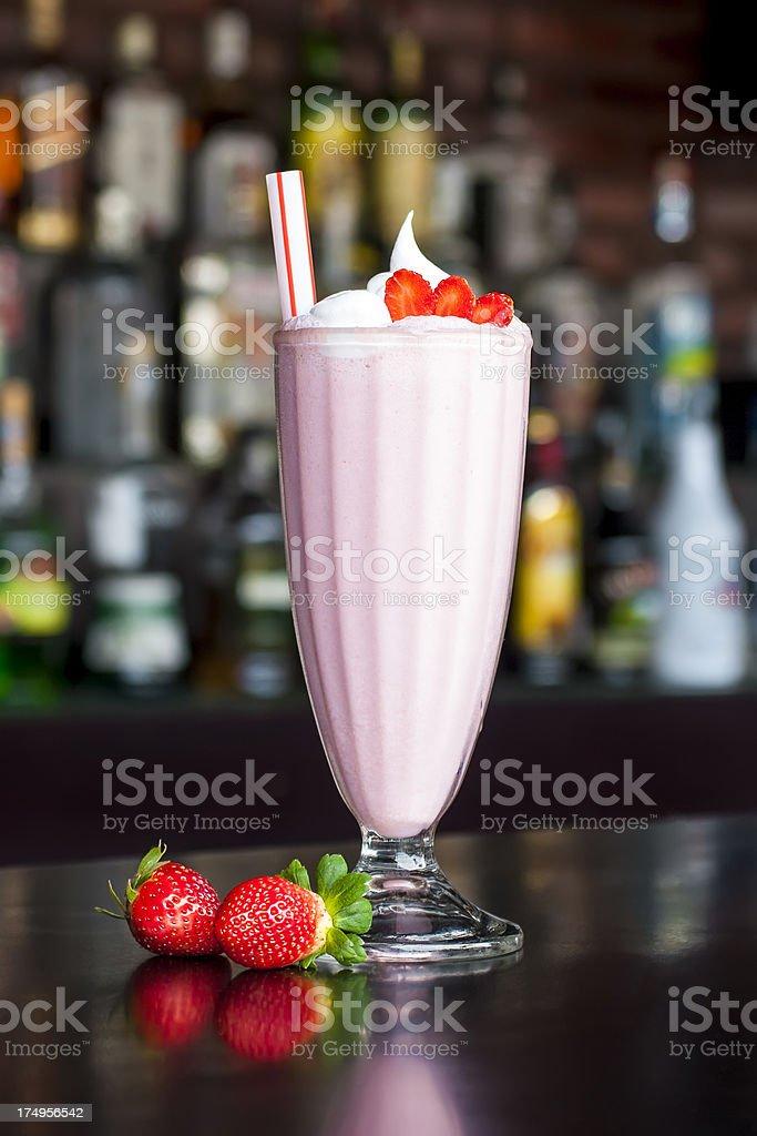 non-alcoholic strawberry milkshake cocktail on the classic black bar table stock photo
