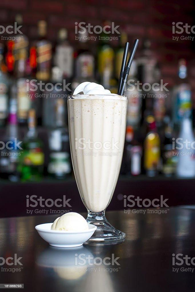 non-alcoholic vanilla milkshake cocktail on the classic black bar table stock photo