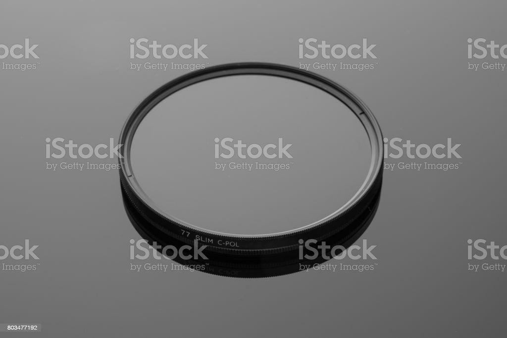 Noname 77mm circular polarizer filter stock photo
