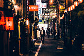 Tokyo, Japan - May 14, 2015: Businessmen walking the narrow streets of Nonbei Yokocho full of tiny bars and restaurants. Nonbei Yokocho means Drunkard's Alley, it is very close to famous Shibuya crossing.
