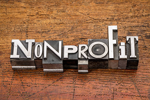nonprofit word in metal type stock photo