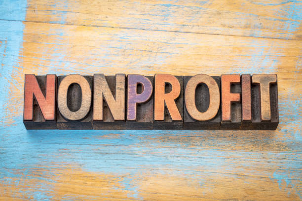 nonprofit word  in wood type stock photo