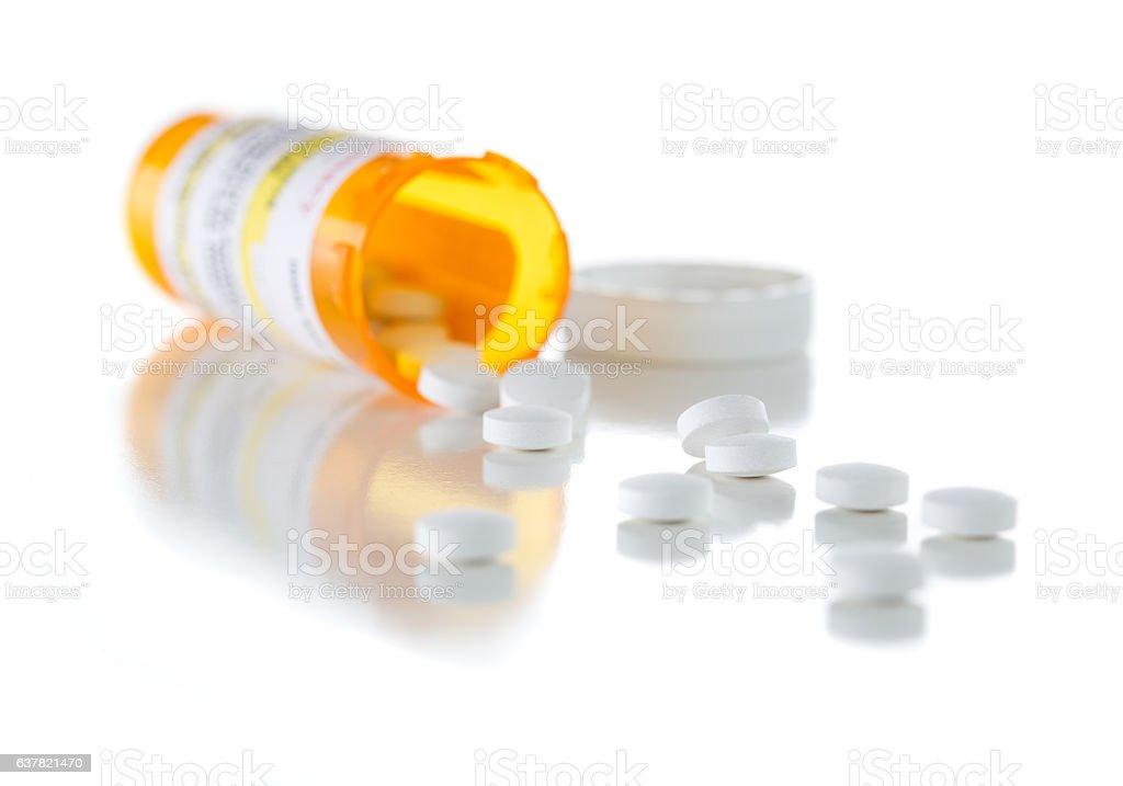 Non-Proprietary Medicine Prescription Bottle and Spilled Pills I stock photo