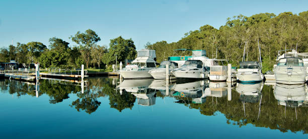 Non-urban waterfront maritime marina/dock with boats. stock photo