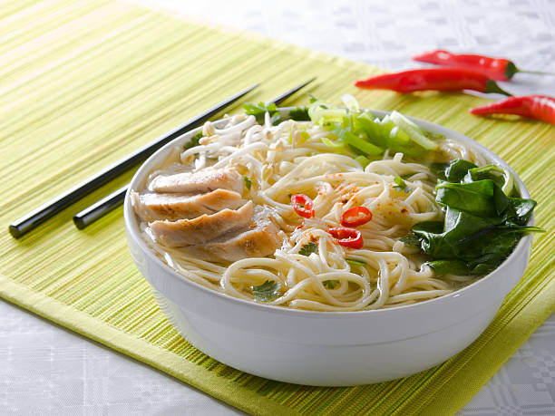 Noodle soup with chicken stock photo