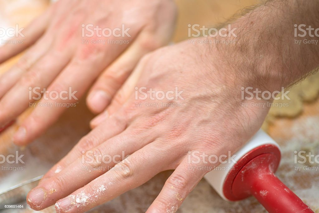 Noodle wood with hands stock photo