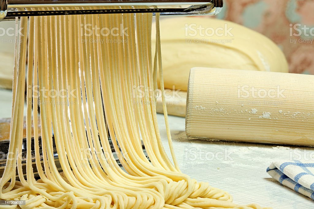 Noodles and pasta machine. stock photo