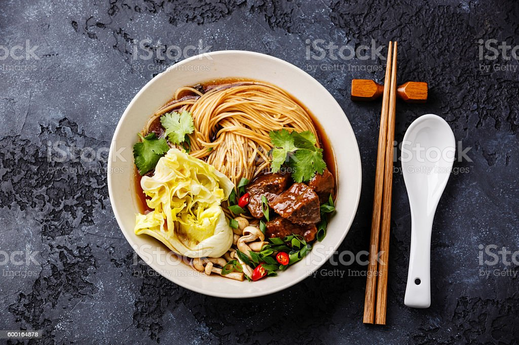 Noodles in broth with Beef stock photo