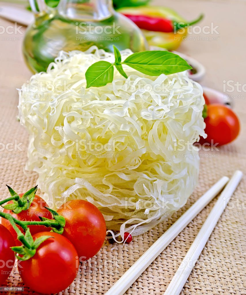 Noodles rice twisted with oil and vegetables on sacking royalty-free stock photo