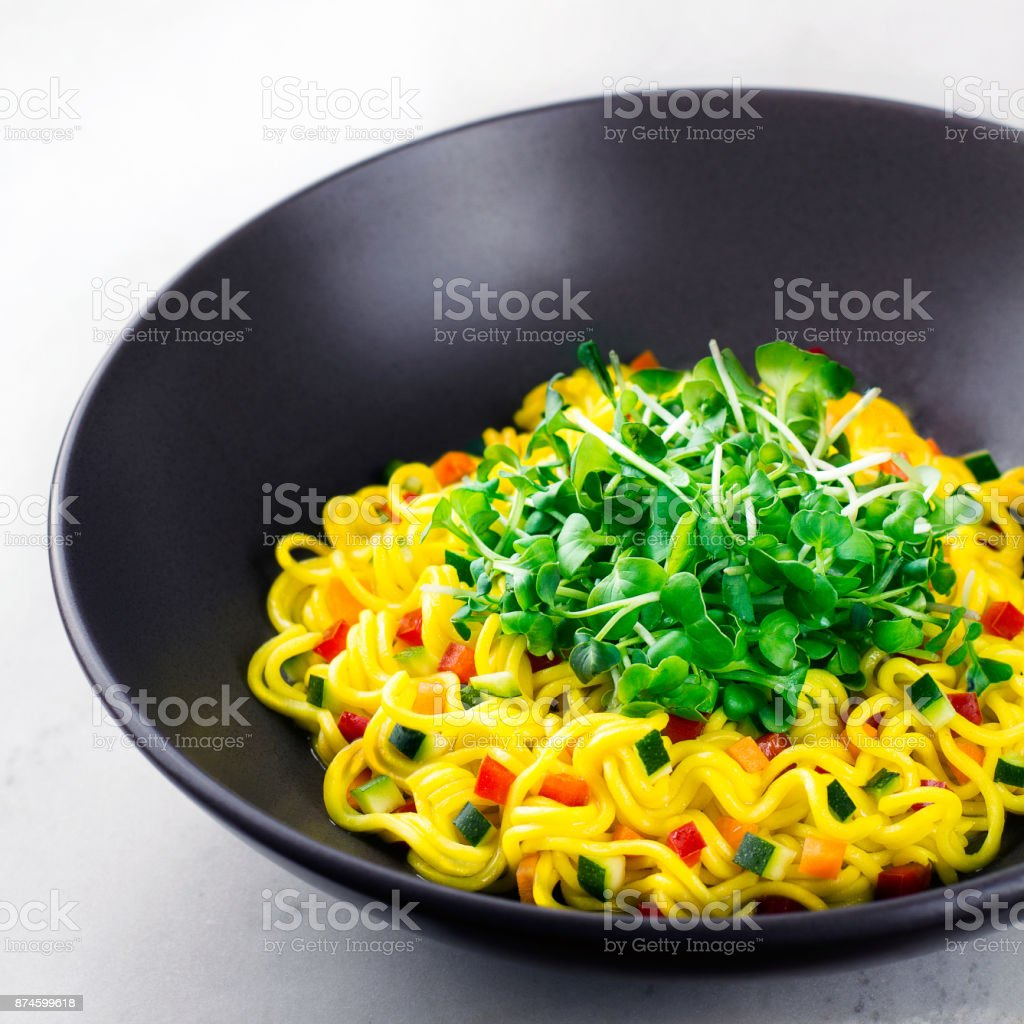 noodles with greens and vegetables stock photo