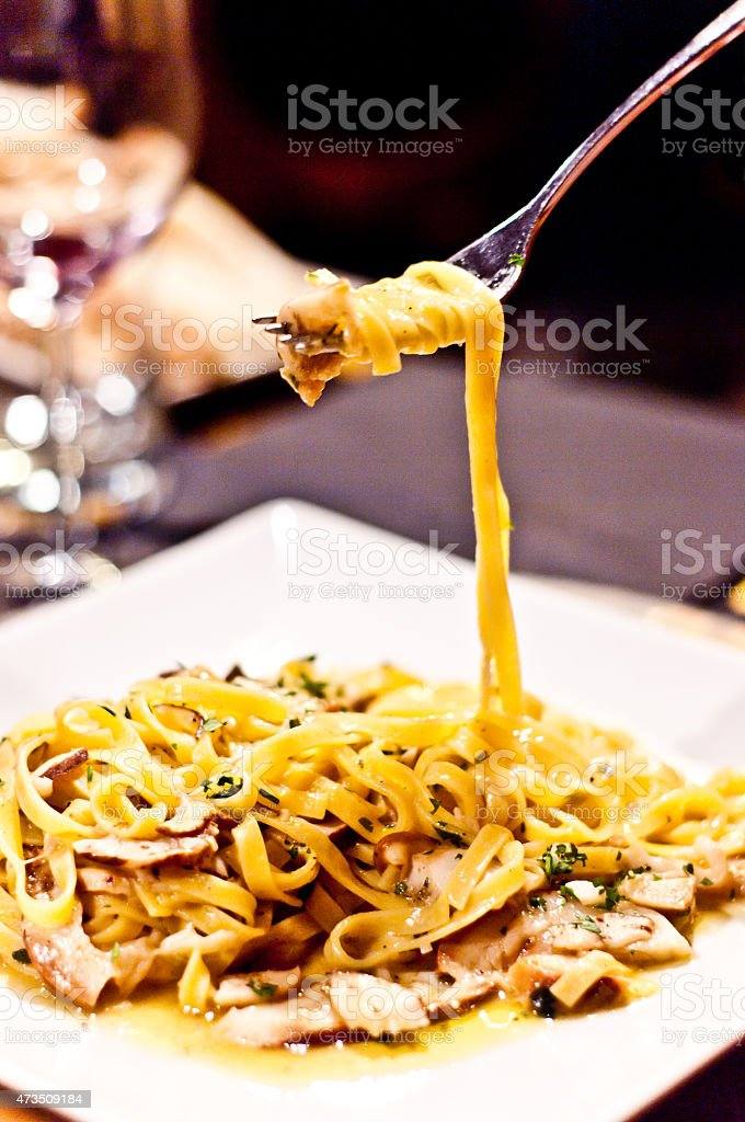 noodles with mushrooms and cheese stock photo