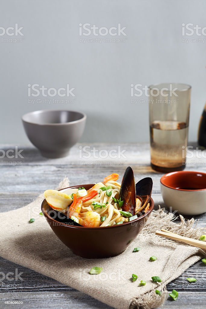 noodles with shrimp and onions stock photo