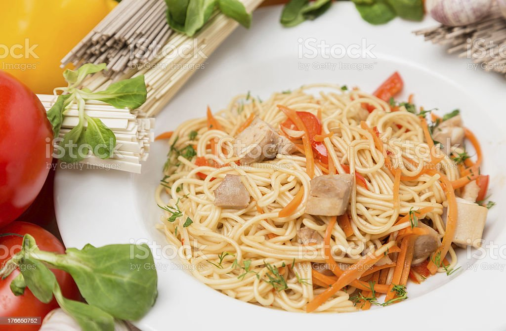 noodles with vegetables and garnish on white plate royalty-free stock photo