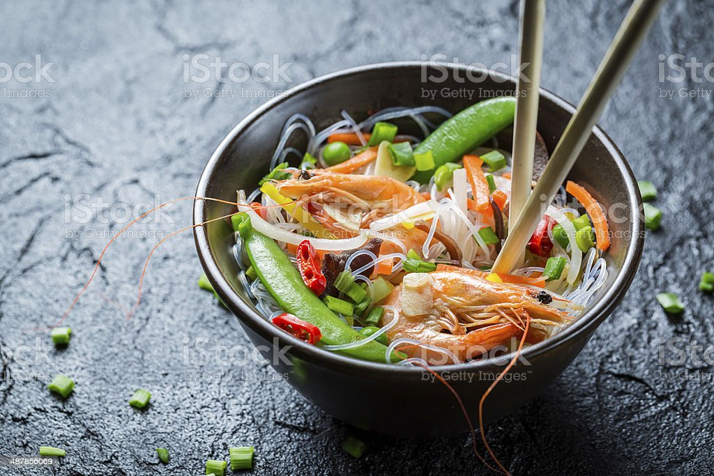 Noodles with vegetables and prawns stock photo