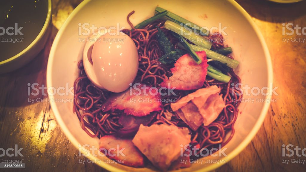Noodles with wontons and char siu stock photo